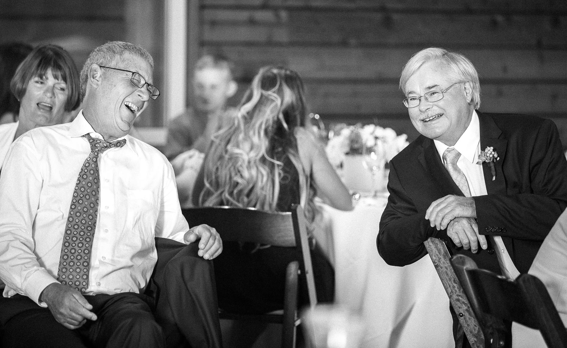 Father of bride and groom in candid wedding reception shot in whistler