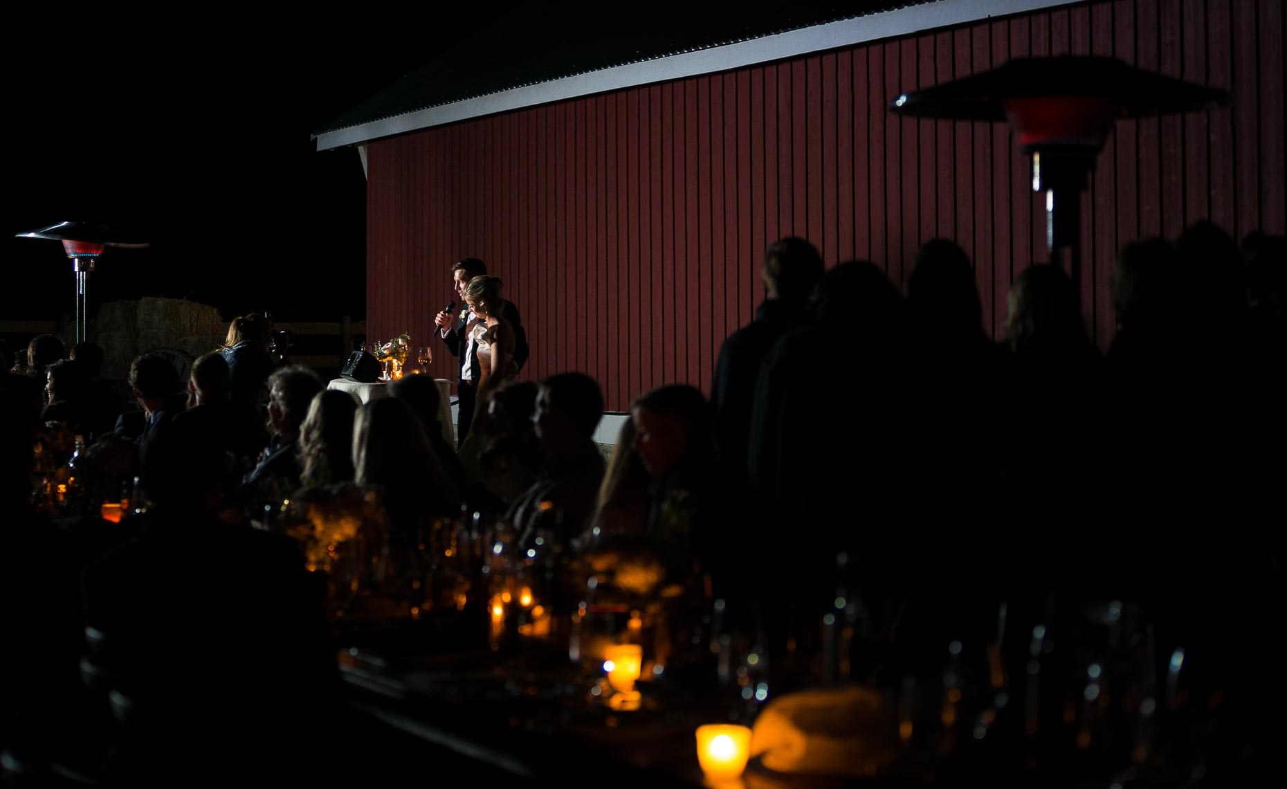 Candle light wedding reception speeches after dark near Whistler, BC