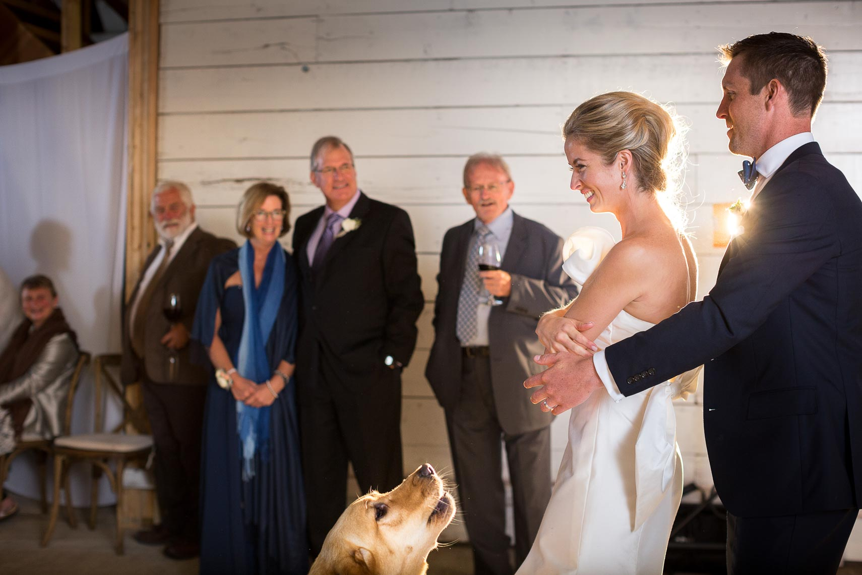 Genuine moment during first dance at vintage style barn wedding in Pemberton BC