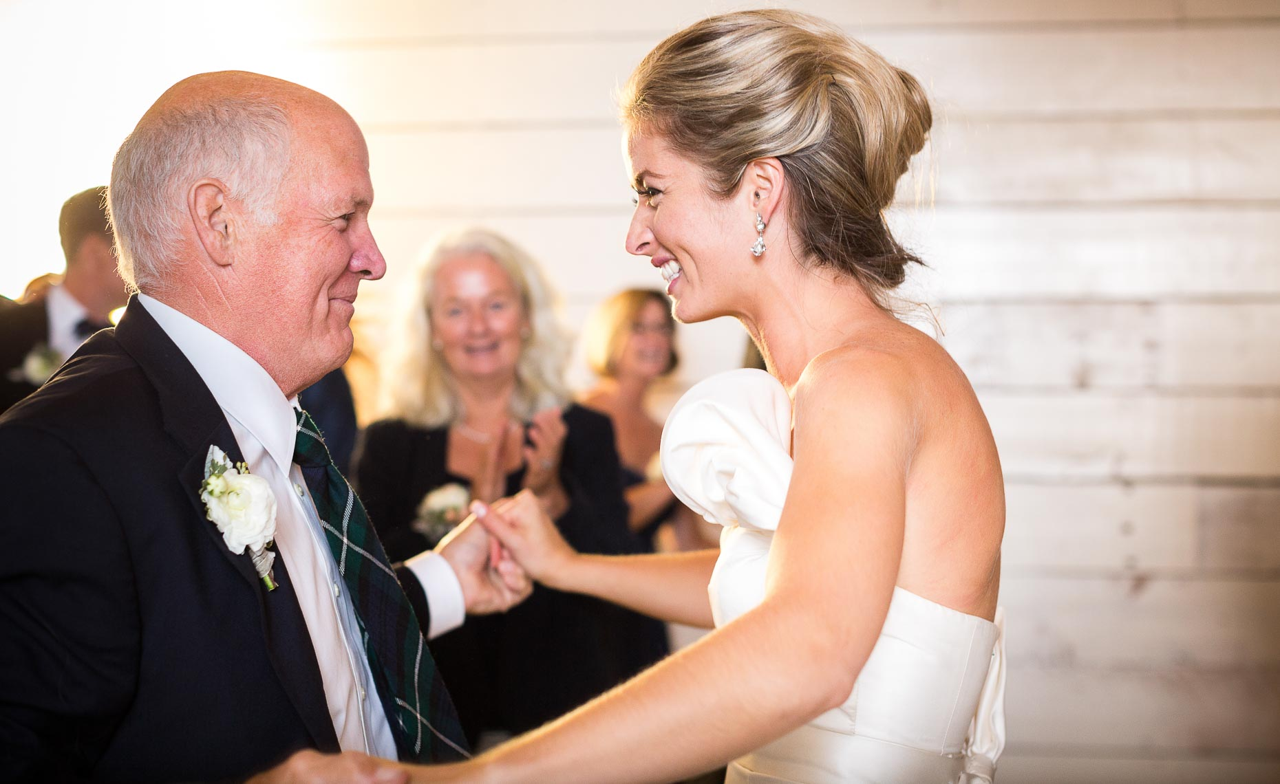 Father and bride dance during vintage barn wedding near Whistler, BC